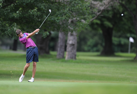 WARREN, OHIO - JULY 16, 2014: Jacob Wilson of Sharon follows through on his approach shot on the 6th hole Wednesday afternoon at Trumbull Country Club during the Vindy Greatest Golfer tournament. (Photo by David Dermer/Youngstown Vindicator)