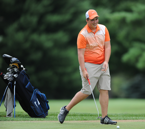 WARREN, OHIO - JULY 16, 2014: Cameron Gumble of Austintown smiles while lining up his putt on the 5th hole Wednesday afternoon at Trumbull Country Club during the Vindy Greatest Golfer tournament. (Photo by David Dermer/Youngstown Vindicator)