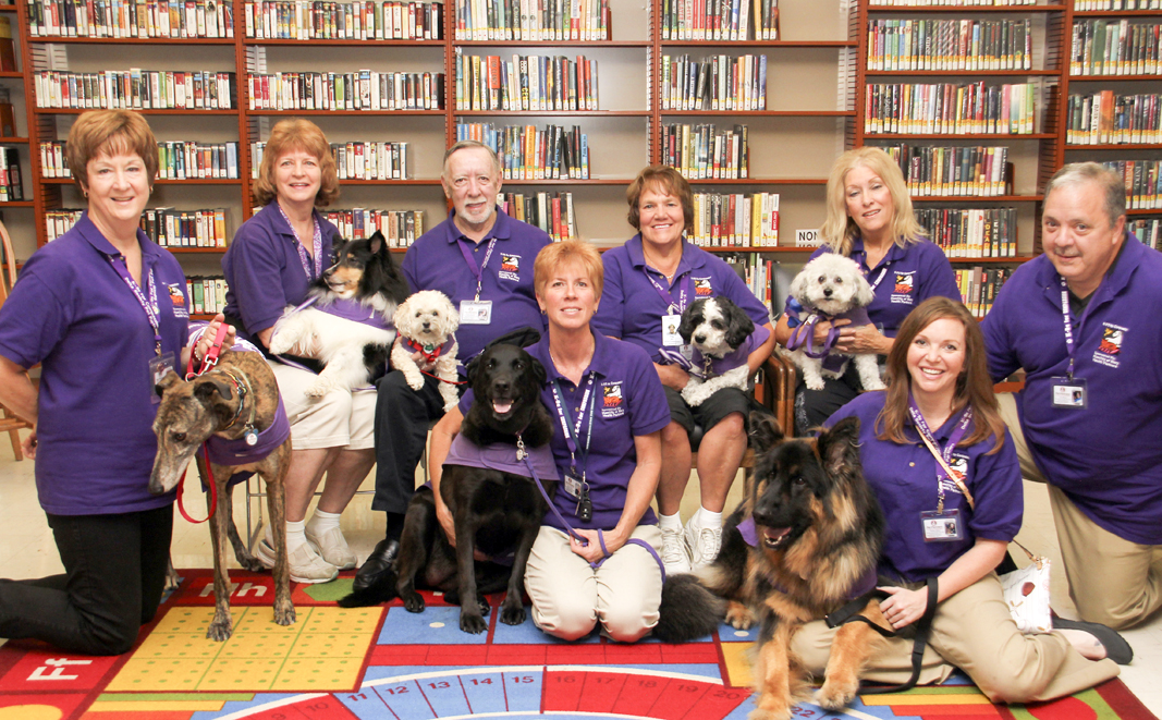 Members of K-9's for compassion, a pet partners affiliate, visited guests at the Brownlee Woods branch of the Public Library of Youngstown on Saturday afternoon.   Dustin Livesay  |   The Vindicator 7/19/14  Youngstown.