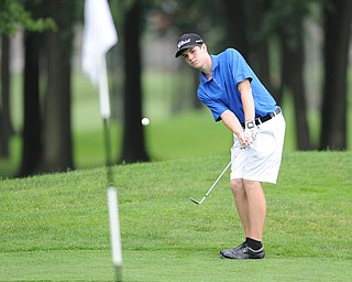 WARREN, OHIO - JULY 27, 2014: Nicholas Hough chips his ball from the short rough toward the hole on the 16th hole Sunday afternoon at Avalon Lakes Country Club during the Vindy Greatest Golfer Tournament. (Photo by David Dermer/Youngstown Vindicator)