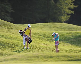 WARREN, OHIO - JULY 27, 2014: Nicolette Eddy chips onto the green from the rough on the 18th hole Sunday afternoon at Avalon Lakes Country Club during the Vindy Greatest Golfer Tournament. (Photo by David Dermer/Youngstown Vindicator) Caddie Alexis Eddy pictured.