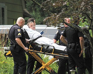 Glenn Fulton, 50, of Youngstown, accused of leading police on a  high-speed chase and barricading himself in a Kiwatha Road home, is moved on a stretcher after negotiations with police.