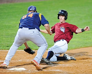 Scrappers baserunner Austin Fisher is tagged out by State College pitcher Kyle Grana when Fisher tried to score on a passed ball in Monday's game at Eastwood Field in Niles.