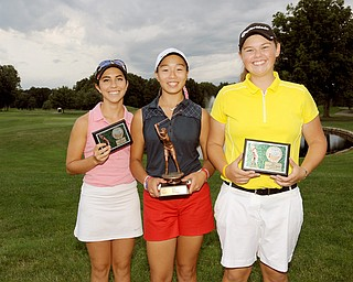 U-17 Girls Christina Cooper, Jacinta Pikunas and Kaylee Neumeister pose for a picture with their trophies Sunday evening at Avalon Lakes Country Club, wrapping up the 2014 Greatest Golfer of the Valley Junior Tournament.