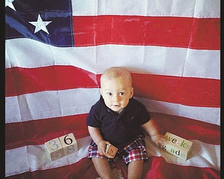 Rocco Joseph Fitzgerald celebrating his first Fourth of July .He is the son of Chad & Kellie Fitzgerald of Chicago . Submitted by grandparents Henry & Patricia Pisciuneri,