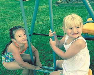 Sophia Barringer and Addison Shotts, cousins, are playing at a picnic at Nana's house in North Jackson. Nana is also known as Barbara Barringer.