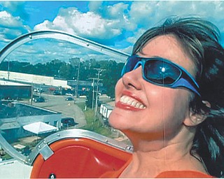 A day at the park high in the sky on the ferris wheel is Rhonda S. Filipan of Stow, Ohio. Sent by Ron and Loretta Filipan of Girard.