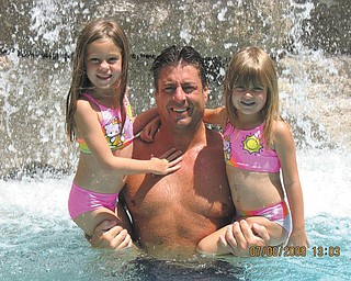 Jeff Croyle holding his two beauties while enjoying the water.