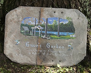 ROBERT K. YOSAY  | THE VINDICATOR.. The Garden is named after Father Dave's mother..Our Lady of the Lakes Parish-- has an oasis for solitude or just reflection or just enjoying the flowers as the Rev. David W. Merweiler is pastor and gardener.....  -30-