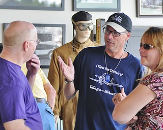Jeff Lange | The Vindicator  Owner of the Ernie Hall Aviation Museum, Bill Griffin, answers some questions for Vindy news writer Bob Jackson Saturday afternoon at his museum in Warren.