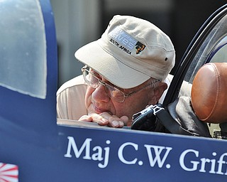 Jeff Lange | The Vindicator  Kinsman native Ed Thompson gets a closer look at a F4U Corsair during the Wings and Wheels fundraiser at the Ernie Hall Aviation Museum, Saturday afternoon in Warren.