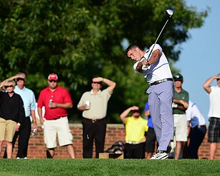 CANFIELD, OHIO - AUGUST 16, 2014: Tim Morrow follows through on his tee shot during the longest drive contest Saturday evening at Tippecanie Country Club. (Photo by David Dermer/Youngstown Vindicator)