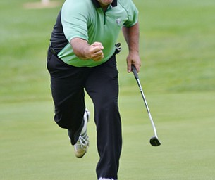 Jeff Lange | The Vindicator  Rick Leonard of Niles celebrates as his putt drops into the hole, during the Greatest Golfer event held at the Lake Club on Monday.