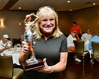Jeff Lange | The Vindicator  Pam Porter shows off the trophy she won in Monday's women's longest drive competition.