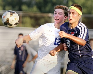 William D. Lewis the Vindicator  Poland's David Watson(12) and Fitch's Tony Mortaro(3) go for the ball during Tuesday 8-19-14 action at Poland.