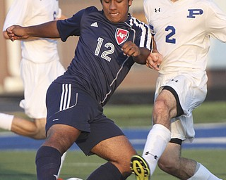 William D. Lewis the Vindicator  Poland's Bryan Partika(2) and Fitch's KDavid Watson(12) go for the ball during Tuesday 8-19-14 action at Poland.