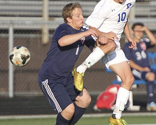 William D. Lewis the Vindicator  Poland's Anthony Sabula(10) and Fitch's Tex Martin(1) go for the ball during Tuesday 8-19-14 action at Poland.