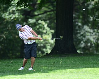 YOUNGSTOWN, OHIO - AUGUST 23, 2014: Matt Gurska chips out of the short rough on a hole on the back 9 of the Youngstown Country Club during the Vindy Greatest Golfer Tournament. (Photo by David Dermer/Youngstown Vindicator)