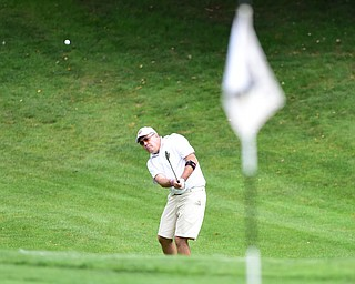 YOUNGSTOWN, OHIO - AUGUST 23, 2014: Bob Kish follows through on his approach shot on a hole on the back 9 of the Youngstown Country Club during the Vindy Greatest Golfer Tournament. (Photo by David Dermer/Youngstown Vindicator)