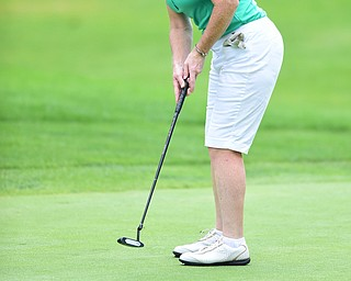 YOUNGSTOWN, OHIO - AUGUST 23, 2014: Mary Kane follows through on her putt on the front 9 of the Youngstown Country Club during the Vindy Greatest Golfer Tournament. (Photo by David Dermer/Youngstown Vindicator)