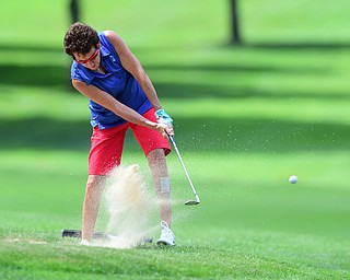 YOUNGSTOWN, OHIO - AUGUST 23, 2014: Jill Harmon chips out of the bunker front 9 of the Youngstown Country Club during the Vindy Greatest Golfer Tournament. (Photo by David Dermer/Youngstown Vindicator)