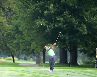 WARREN, OHIO - AUGUST 23, 2014: Griffin Todd of Canfield follows through on his approach shot on the 1st hole Saturday morning at Trumbull Country Club during the Vindy Greatest Golfer Tournament. (Photo by David Dermer/Youngstown Vindicator)