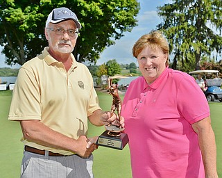 Jeff Lange | The Vindicator  Women 9+ Handicap champ Lori Bowden with The Vindicator's Ted Suffolk.