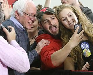 ROBERT K. YOSAY  | THE VINDICATOR..Bernie Sanders  gets a selfie  with Marino November and Mickal Mymo both seniors .. - -30-...