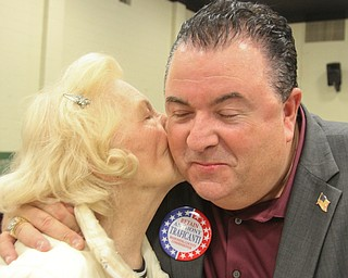 William D. Lewis The Vindicator Anthony Traficanti, Mahoning County Commissioner gets a kiss from his mother Barbara Ann Traficanti during an election night party at St Luke Hall in Boardman.