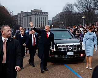 President Donald Trump and first lady Melania Trump walk near the White House in the inaugural parade after he was sworn in as the 45th President of the United States, Friday, Jan. 20, 2017, in Washington. (AP Photo/Evan Vucci, Pool)