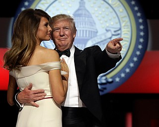 President Donald Trump dances with first lady Melania Trump at the Liberty Ball, Friday, Jan. 20, 2017, in Washington. (AP Photo/Alex Brandon)