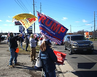Supporters of President Donald Trump hold flags and signs at the Summitville Tile parking lot on 224, Saturday, March 4, 2017 in Boardman. ..(Nikos Frazier   The Vindicator)..