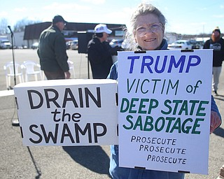 Michele Zolnier of Sharon holds two signs at the Summitville Tile parking lot on 224, Saturday, March 4, 2017 in Boardman. ..(Nikos Frazier   The Vindicator)..