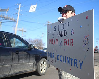 """Tom Pressly of Poland holds a """"stop and pray for our country"""" sign as he and others show their support for President Donald Trump at the Summitville Tile parking lot on 224, Saturday, March 4, 2017 in Boardman. ..(Nikos Frazier   The Vindicator).."""