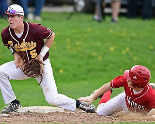 COLUMBIANA, OHIO - APRIL 20, 2017: South Range's Brycen James, left, blocks the ball while Columbiana's Zach Fans slides into third in the fifth inning of Thursday evenings game at Firestone Park. Columbiana won 4-2. DAVID DERMER   THE VINDICATOR