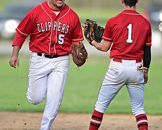 COLUMBIANA, OHIO - APRIL 20, 2017: Columbiana's Tim Davin, left, celebrates with Chase Franken after catching the ball for the final out to end the game, Thursday evening at Firestone Park. Columbiana won 4-2. DAVID DERMER   THE VINDICATOR