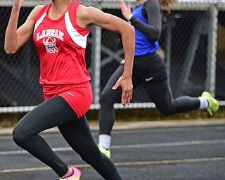 POLAND, OHIO - APRIL 29, 2017: LaBrae's Dynesty Ervin sprints to the finish line ahead of Gilmour Academy's Lucia Cannata during their heat of the girls 100 meter dash, Saturday morning during the Poland Invitational at Poland High School. DAVID DERMER | THE VINDICATOR