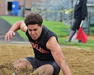 POLAND, OHIO - APRIL 29, 2017: Howland's Stephen Baugh sticks the landing during the boys long jump, Saturday morning during the Poland Invitational at Poland High School. DAVID DERMER | THE VINDICATOR