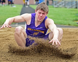 POLAND, OHIO - APRIL 29, 2017: Champion's Noah Bayus sticks the landing during the boys long jump, Saturday morning during the Poland Invitational at Poland High School. DAVID DERMER | THE VINDICATOR