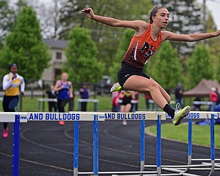 POLAND, OHIO - APRIL 29, 2017: Newton Falls Tori Blandine clears a hurdle during her heat of the girls 300 meter hurdles, Saturday morning during the Poland Invitational at Poland High School. DAVID DERMER | THE VINDICATOR