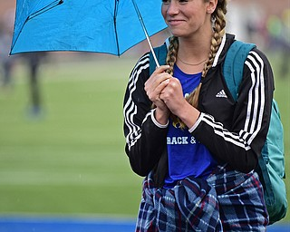 POLAND, OHIO - APRIL 29, 2017: Valley Christian's Tess Emerson stands under her umbrella as the rain starts to fall while watching the girls high jump, Saturday morning during the Poland Invitational at Poland High School. DAVID DERMER | THE VINDICATOR
