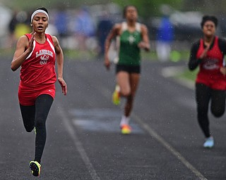 POLAND, OHIO - APRIL 29, 2017: LaBrae's Dynesty Ervin sprints to the finish line ahead of St. Vincet-St. Mary's Payton Pooler and Struthers Khaylah Brown during their heat of the girls 200 meter dash, Saturday morning during the Poland Invitational at Poland High School. DAVID DERMER | THE VINDICATOR