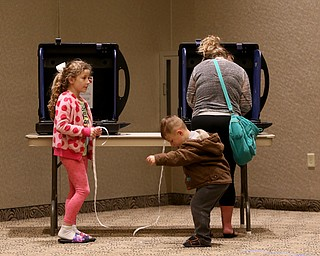 """Ryan(5) McElroy and sister, Lauren(8) play with """"I voted"""" stickers while their mom, Ashley McElroy votes at St. Christine Parish Center, Tuesday, May 2, 2017 in Youngstown. ..(Nikos Frazier 