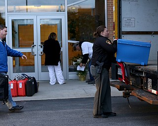 Deputy Stephanie Harchar(right) loads a ballot box into the Board of Elections box truck as Nick Sharpe follows with more at St. Christine Parish Center, Tuesday, May 2, 2017 in Youngstown. ..(Nikos Frazier | The Vindicator)..