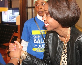 William D. Lewis the vindicator  Carla Baldwin gets congrats during vicotry party. In background is Deloris thompson and friend and supporter.