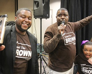William D. Lewis the vindicator  Tito Brown reacts to news he won mayoral primary.  At left is his son Aaron.