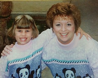 Matching sweaters were worn in this photo of Jessica Crawford of Ravenna and her mother, Crystal Lias of Alliance.