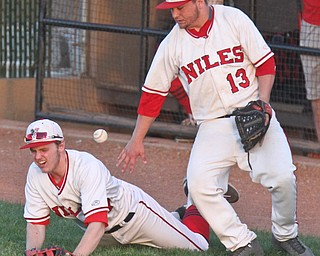 William D. Lewis The Vindicator Niles Tyler Woak(17) and Tyler Srbinovich(13) try to catch a foul ball during gamesat Cene 5-16-17