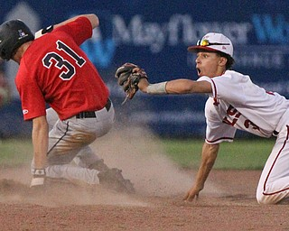 William D. Lewis The Vindicator Canfield's Jack Rafoth(31) steals 2nd during gamesat Cene 5-16-17. Trying to make the tag for Niles is Corbin Foy(3).