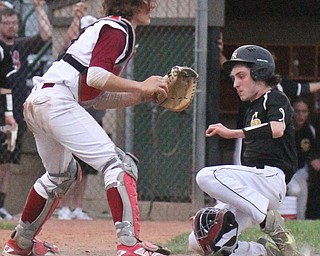 William D. Lewis The Vindicator Cfestview's James Fitzgerald(9) scores as Mooney catcher Dean Lauer(5) waits for the throw during 5-17-17 game at Cene. Crestview won 10-3.